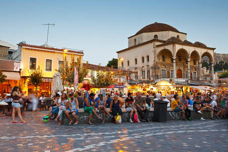 43801074-people-sitting-in-the-square-in-front-of-the-mosque-in-monastiraki-athens